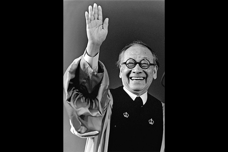 Architect I.M. Pei waves to the audience before receiving his honorary degree at Commencement in 1995. Born in China, Pei came to the Harvard Graduate School of Design and became a friend of the Bauhaus architect Walter Gropius. Known locally for designing the Hancock tower in Boston, Pei has designed buildings across the world. Photo by Marc Halevi