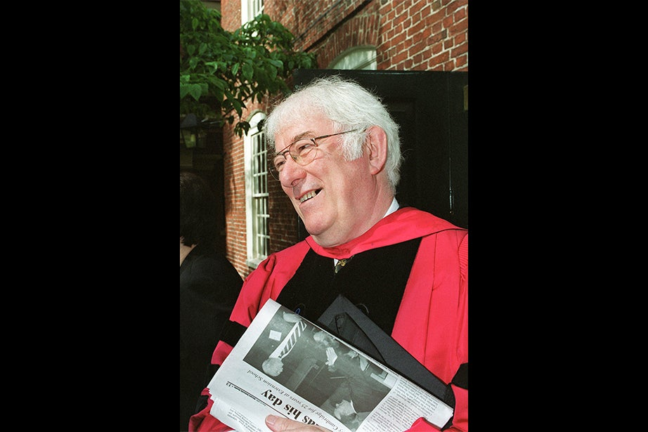 Seamus Heaney pauses outside Massachusetts Hall before receiving an honorary degree at Commencement in 2000. Heaney, an Irish poet, playwright, and lecturer, won the 1995 Nobel Prize in literature. He was a professor at Harvard from 1981 to 1997 and its poet in residence from 1988 to 2006. Photo by Jane Reed