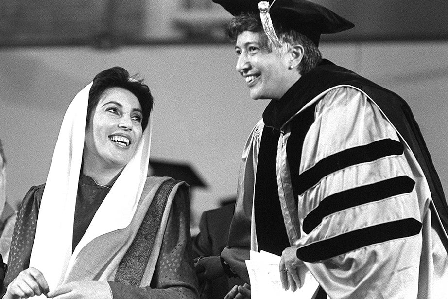Benazir Bhutto (left) and Matina Horner, president of Radcliffe College, share a moment at Commencement in 1989. Bhutto served as prime minister of Pakistan (1993-96), the first woman elected to lead a Muslim state. She was later assassinated in 2007. Horner was an American psychologist who became the sixth president of Radcliffe College in 1972. Photo by Michael Quan