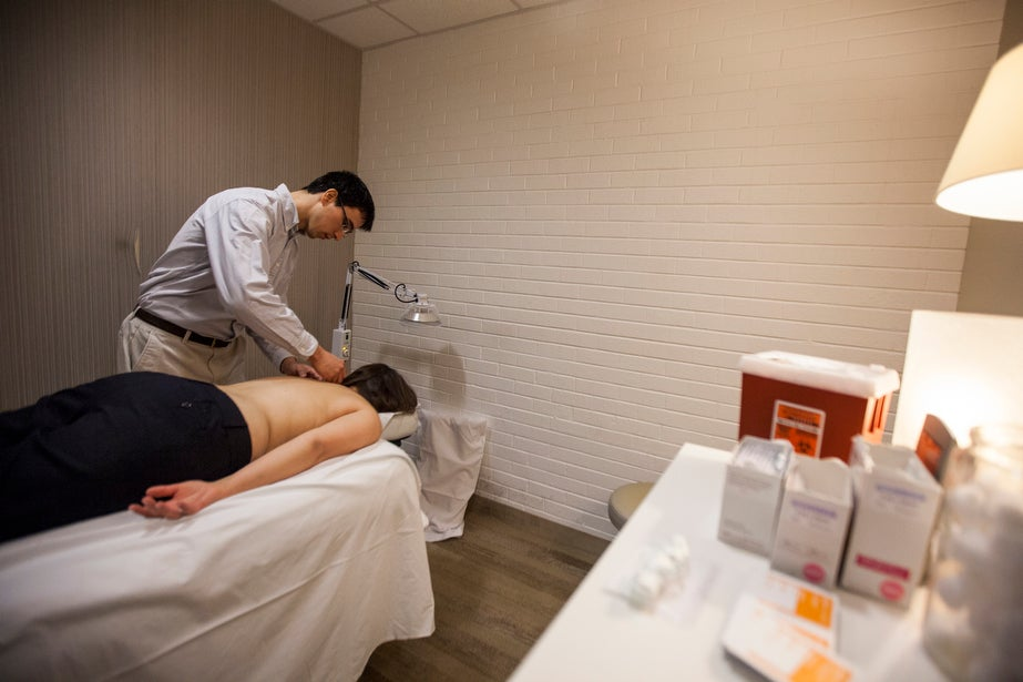 Jeffrey Matrician performs acupuncture at the David S. Rosenthal M.D. Center for Wellness.