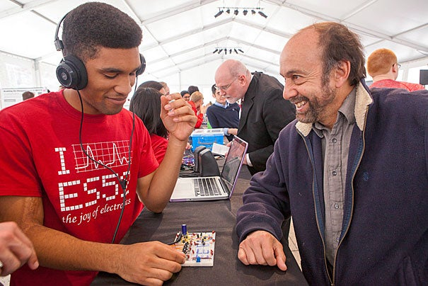 """Adrian Jones '16, a student in ES 52: """"The Joy of Electronics,"""" demonstrates his digital synthesizer for senior lecturer Henry Leitner."""