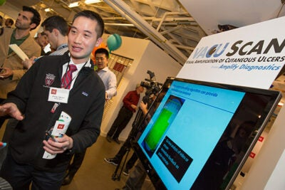 Khang Nguyen (photo 1) of the VACU Scan team explained how a smartphone app can send medical test information from remote areas to hospitals. VACU Scan won first prize in the President's Challenge. Vanessa Beary (left, photo 2) offered information on Powerful Girls Now, one of the 10 finalists in the challenge. Adam La Reau (right, photo 3), founder of One Summit, discussed his project's impact with i-lab Managing Director Gordon Jones and Harvard President Drew Faust.