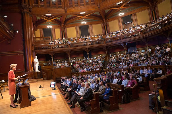 """We're here to build our IT community, to connect more closely to the University mission, and to learn from each other,"" said Harvard CIO Anne Margulies (photo 1) during her opening remarks at the IT Summit at Sanders Theatre. Keynote speaker Professor Clay Christensen (photo 2) addressed online learning's transformation of higher education. ""What Harvard Business School needs to do is think about whether we can use online learning to help our customers-students. I think we can,"" he said."