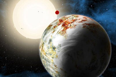 """The newly discovered """"mega-Earth"""" Kepler-10c dominates the foreground in this artist's conception. Its sibling, the """"lava world"""" Kepler-10b, is in the background."""