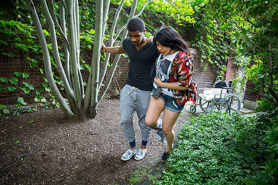 Gerry Ambroise walks the garden — shared with birds, squirrels, and bunnies ― with Annielly Camargo, a student in Crimson Summer Academy.
