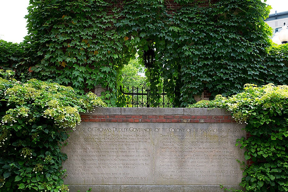 The inscription detailing Thomas Dudley's accomplishments is all that remains of the original Dudley Garden gate.