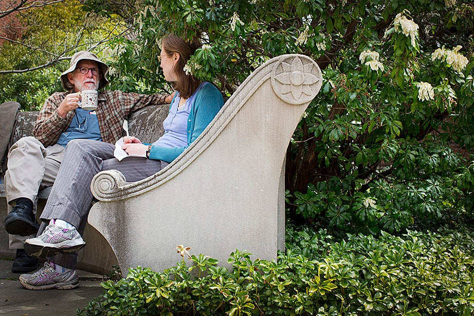 Research librarians Fred Burchstead and Anna Esty enjoy lunch in Dudley Garden.