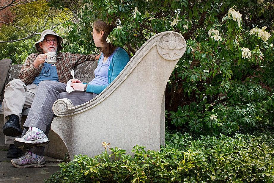 Research librarians Fred Burchstead and Anna Esty enjoy lunch in Dudley Garden.