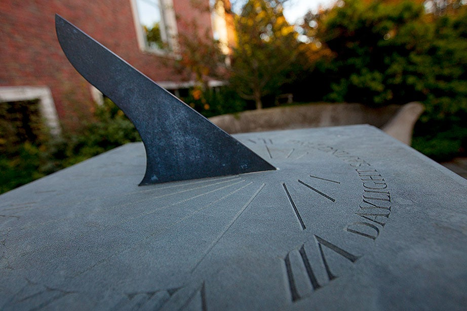 """William J.H. Andrewes, former curator of the Collection of Historical Scientific Instruments at Harvard, designed this bluestone sundial. Andrewes spoke at the garden's unveiling in 1999, and invited guests into """"the peace and tranquility of the garden, where time is measured in shadows."""""""