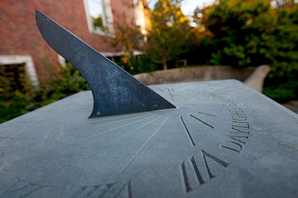 "William J.H. Andrewes, former curator of the Collection of Historical Scientific Instruments at Harvard, designed this bluestone sundial. Andrewes spoke at the garden's unveiling in 1999, and invited guests into ""the peace and tranquility of the garden, where time is measured in shadows."""