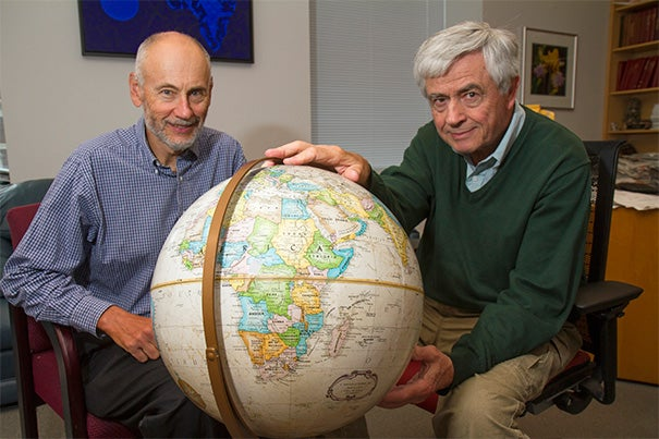 Harvard School of Public Health AIDS Initiative Chair Max Essex (right) has joined with a group of collaborators on the Botswana Combination Prevention Project, a massive trial enrolling more than 100,000 people, age 16 to 64, living in 30 villages across the country. Harvard Professor Victor De Gruttola (left) said faculty and students have devoted years to refining statistical methods to aid in design, monitoring, and analysis of the trial.