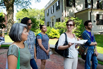 Harvard Summer School instructor Christina Hodge (in sunglasses) leads students Teresa D'Onfro (from left), Jordan Kijewski, Horizon Starwood, and Tom Somi on a tour of Harvard's hidden treasures.