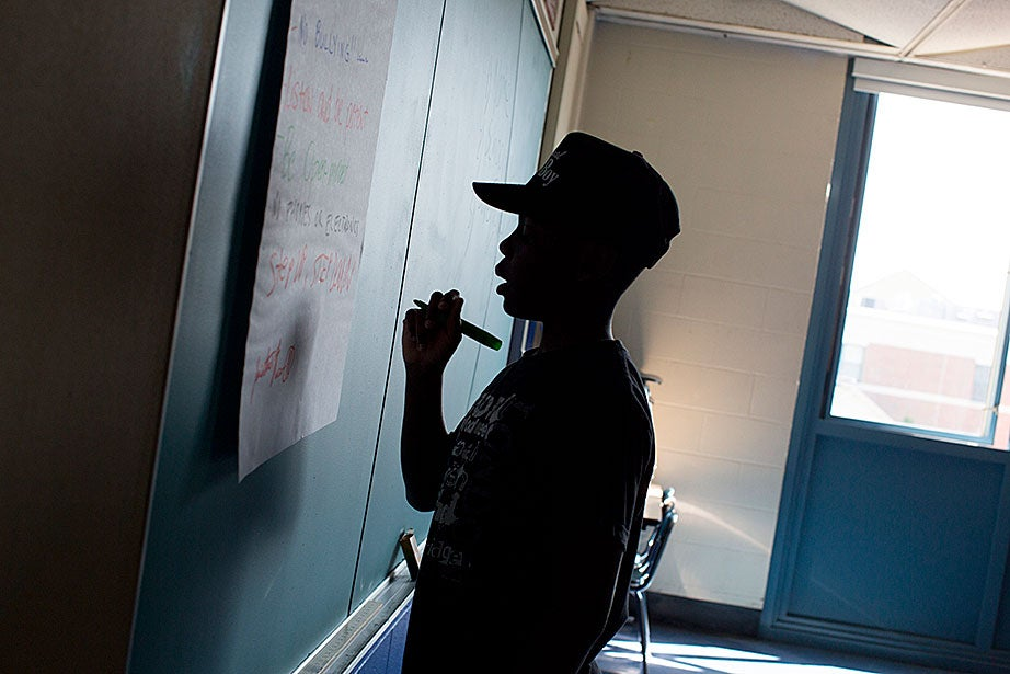 Shafique Holloway, 13, contributes to his classroom's rules.