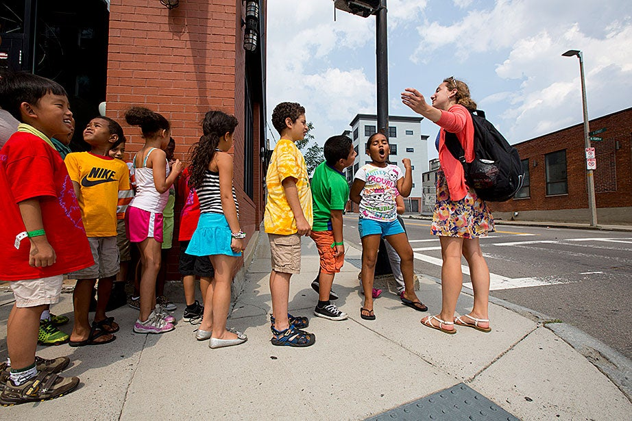 Campers sang and chanted, with the guidance of Halie Olson, as they headed back to the Condon School after a field trip to Harvard Square.