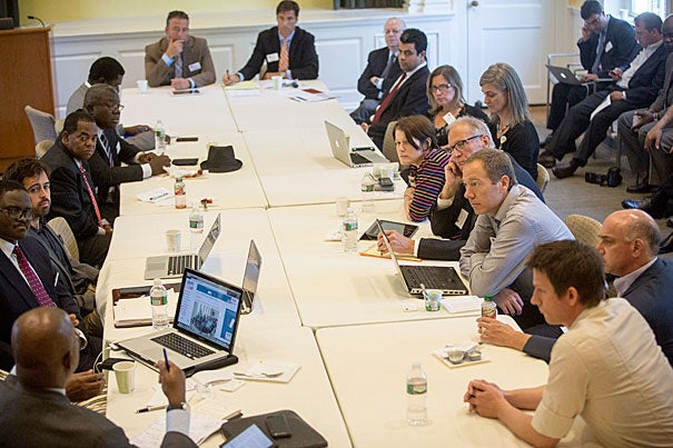 "Prior Ebola outbreaks were relatively small because they were identified early and managed with effective quarantines, said Gregory Ciottone (head of table, left), director of the Disaster Medicine Division at Beth Israel Deaconess. ""How long is it going to be? There's no way to predict."" Ambassadors and officials from West African nations came to Harvard for a discussion organized by the Harvard Humanitarian Initiative. It allowed officials to ask questions of medical experts and exchange views about strategies to ease the crisis."