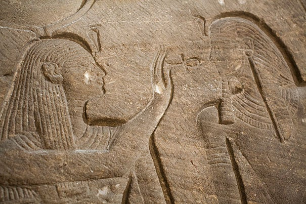 Detail from an ancient Egyptian sandstone temple relief (photo 1) at the Harvard Semitic Museum. Harvard Egyptologist Peter Der Manuelian (photo 2) outlines the life of museum founder David Gordon Lyon, pictured far right. Manuelian's co-lecturers Adam Aja (left, photo 3) and Joseph A. Greene.