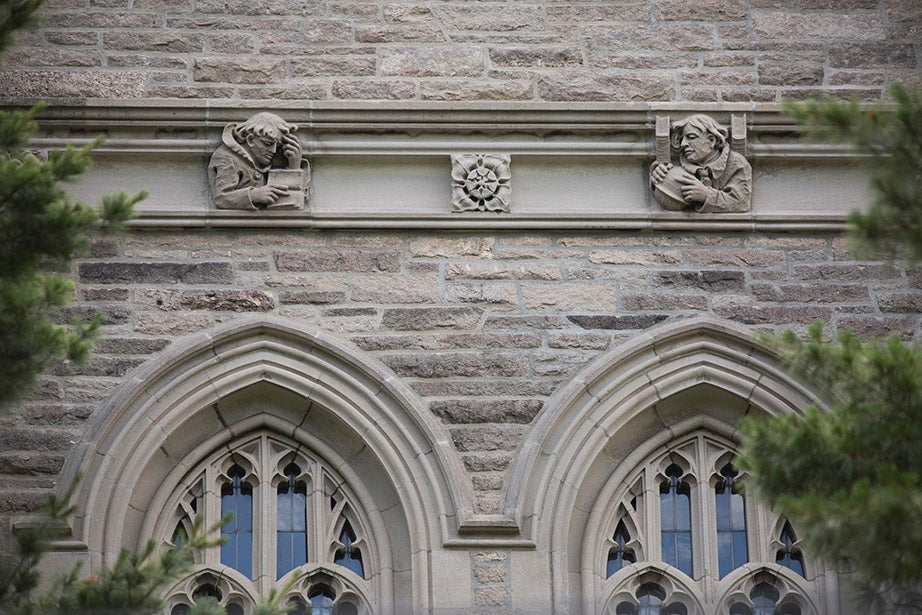 The central tower of Harvard Divinity School's Andover Hall (1911) includes faces of the early Christian evangelists Matthew, Mark, Luke, and John.