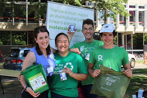 With a table set up by the Science Center today, FAS Green Program residential coordinator Kelsey  (from left), Joy Wang '16, Jordan Weirs '16, and Michael O'Brien '17 were ready to educate incoming freshmen on composting, recycling, and the other benefits of green living in Harvard Yard.