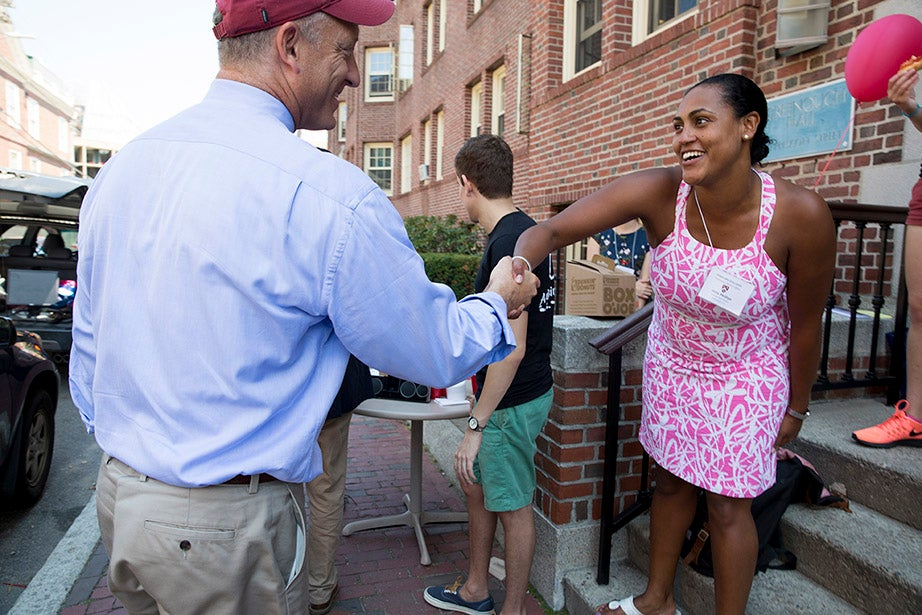 Dean of the Faculty of Arts and Sciences Michael D. Smith greets Jeita Phillips, a proctor in Greenough. Rose Lincoln/Harvard Staff Photographer