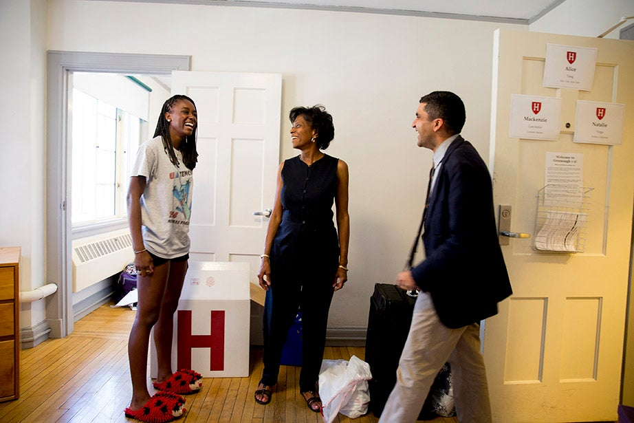 In Greenough Hall, Harvard College Dean Rakesh Khurana laughs with MacKenzie Lawrence '18 and her mother, Sandra, of Leawood, Kan. Rose Lincoln/Harvard Staff Photographer