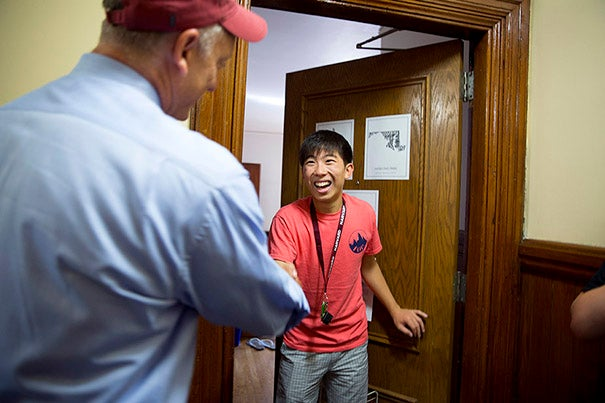 Faculty of Arts and Sciences Dean Michael D. Smith greets Handong Park '18 in Matthews Hall in Harvard Yard. Rose Lincoln/Harvard Staff Photographer