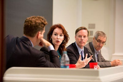 In a panel talk moderated by Harvard Law School Professor Noah Feldman (from left), Meghan O'Sullivan, Nicholas Burns, and Michael Ignatieff assessed the global threat now posed by the Sunni jihadist group known as the Islamic State of Iraq and the Levant (ISIL).