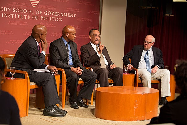 """A panel convened by Professor Charles Ogletree (from left) reflected on the broad social, legal, and political issues raised by the protests in Ferguson, Mo., last month. """"I'm not alleging any type of conspiracy. Just know that many people — minority and majority — think something is terribly wrong,"""" said the Rev. Ray Hammond. Also on the panel were Lee P. Brown, the first African-American commissioner of police for Atlanta, and Alex Jones, director of the Shorenstein Center."""