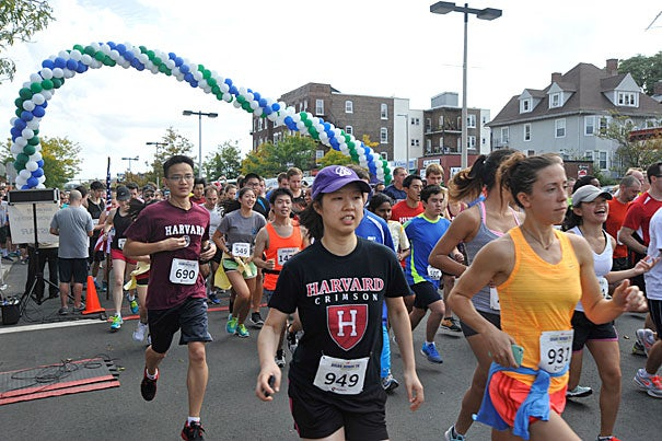 Harvard undergraduates Kwan-Keat Ang (left) and  Jenny Shih (center) were two of several hundred Harvard runners participating in the 11th annual Brian J. Honan 5K Run/Walk in Allston-Brighton (photo 1). Scott Kallgren, a postdoctoral fellow at Harvard Medical School, earned his medal from the race (photo 2), as did Nathan Cummings '18 (photo 3), who averaged just under a six-minute mile pace, finishing third in his age group, and 16th overall out of 1,077 runners who finished.