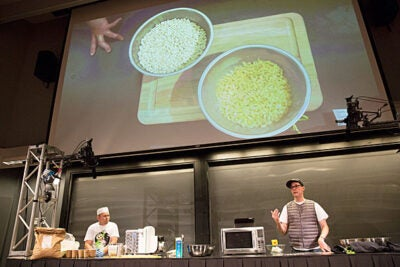 Chef Mark Ladner (right) and pasta maker Carlos Rodrigues churned out gluten-free pasta at a Science and Cooking lecture Monday night.