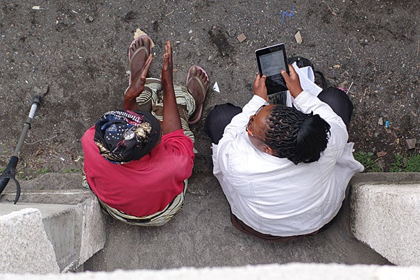 Harvard Humanitarian Initiative researchers Patrick Vinck and Phuong Pham (not pictured) developed a tablet-based software to interview Democratic Republic of the Congo residents (photo 1). Coordinated teams of interviewers set out over five weeks to gather information (photo 2). Vinck briefed interviewers prior to their return to the field to conduct surveys (photo 3).