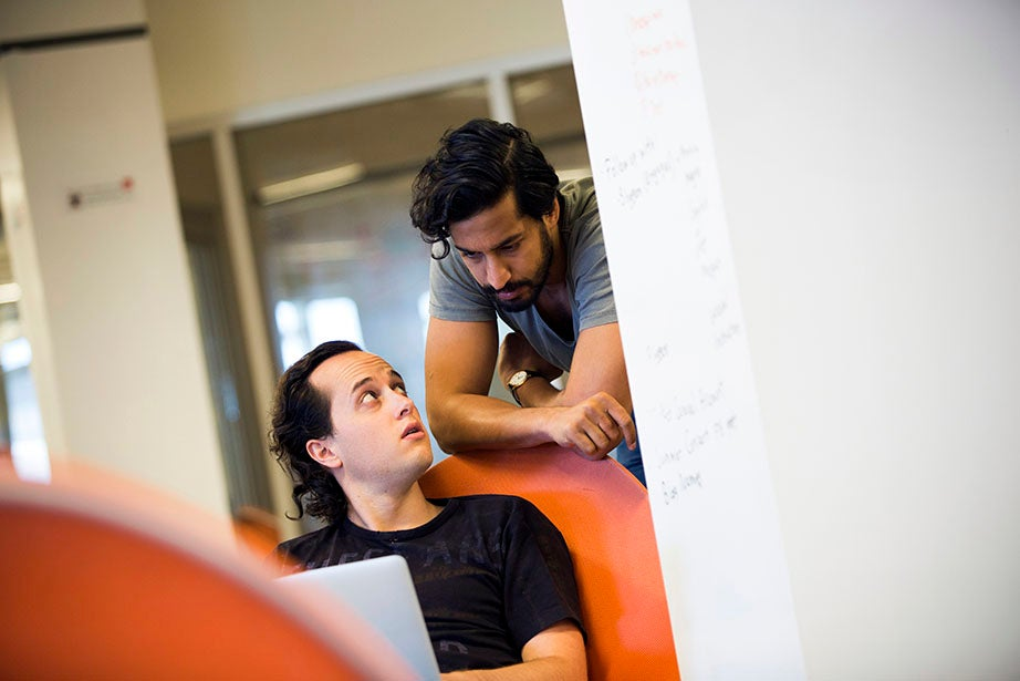 Harvard Business School students Daniel Vogel (left) and Rahil Gupta work together on OctopusFX, which connects the world's banking institutions via cryptocurrencies.