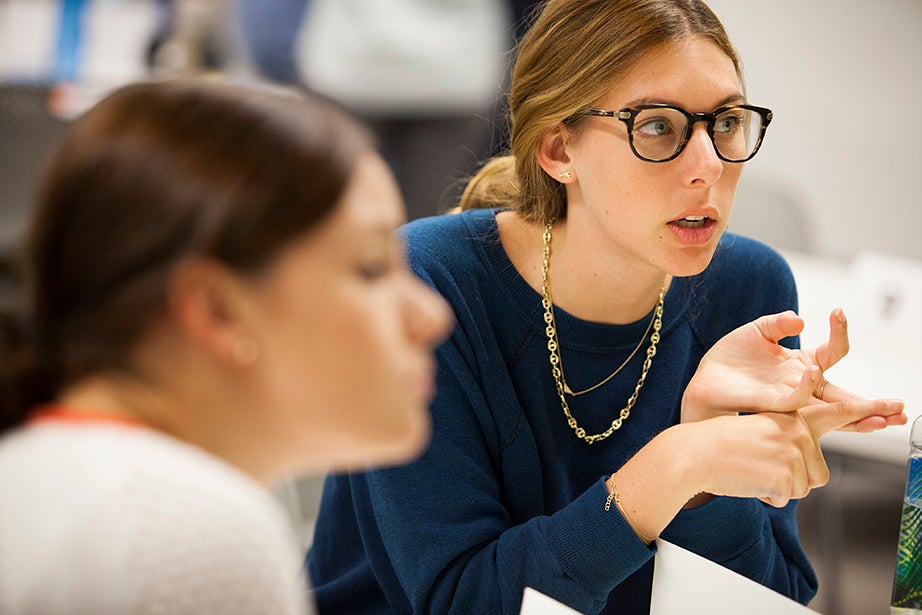 Harvard Business School student Jillian Ressler (center) makes a point during a discussion.