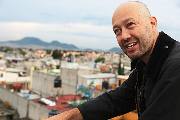"""Mexico City architect Jose Castillo, M.Arch. '95, D.Des. '00, on the rooftop of an affordable housing complex that his firm designed. Building in a megacity of 21 million, he said, is always """"a struggle towards equity."""""""