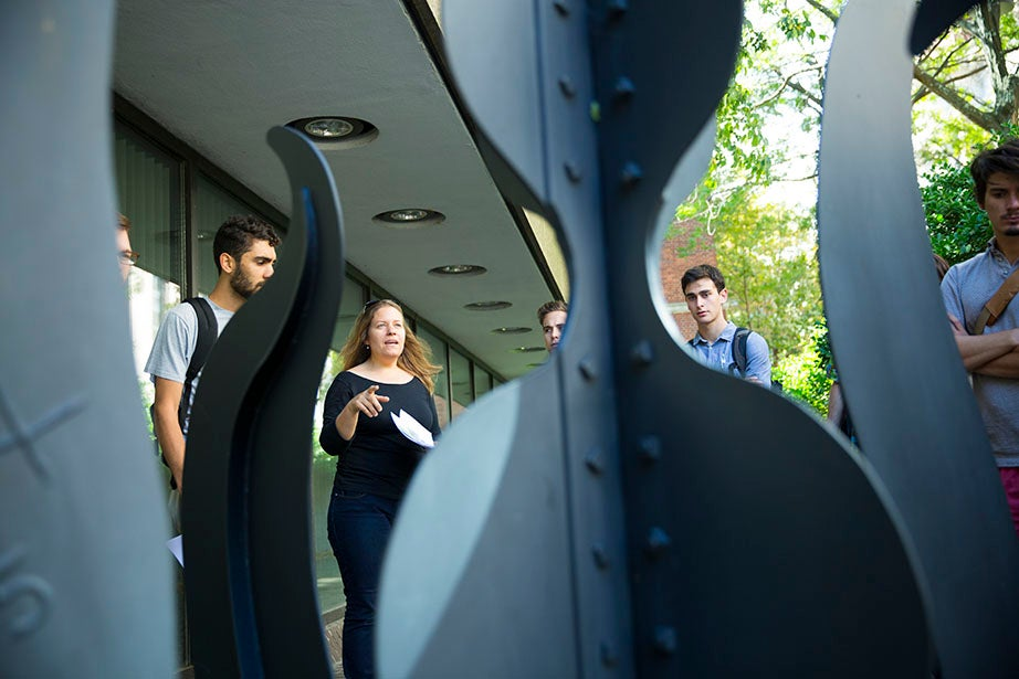 This VES class tours the campus observing various sculptures, including the Alexander Calder sculpture in front of Pusey Library. Stephanie Mitchell/Harvard Staff Photographer