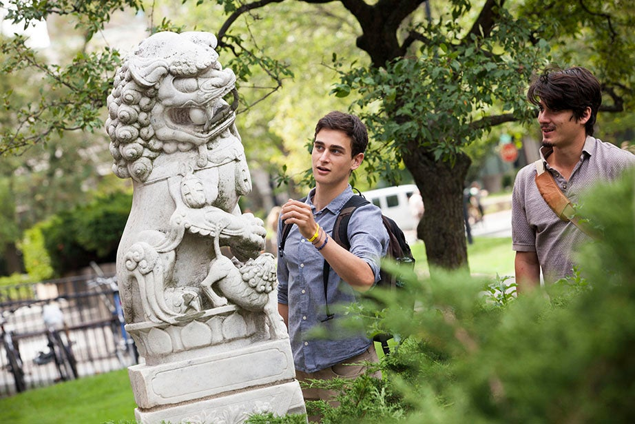 Michael Rothberg '17 (left) and Francisco Maldonado Andreu '14/'15 examine the sculptures in front of the Harvard-Yenching Library. Stephanie Mitchell/Harvard Staff Photographer
