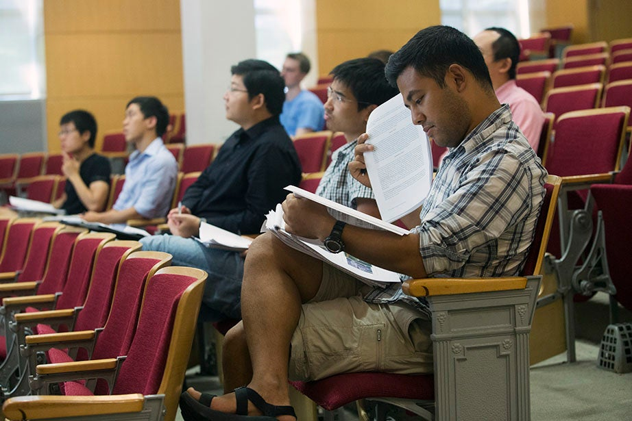 """Students settle in for """"Frontiers in Biophysics"""" in Pfizer Lecture Hall. Jon Chase/Harvard Staff Photographer"""