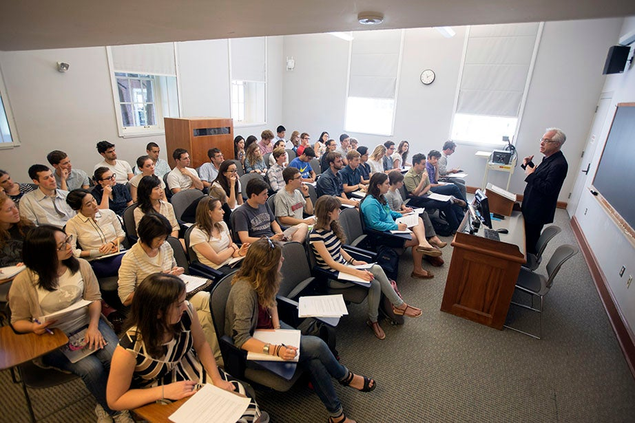 Louis Menand speaks to a full classroom inside Harvard Hall. Kris Snibbe/Harvard Staff Photographer