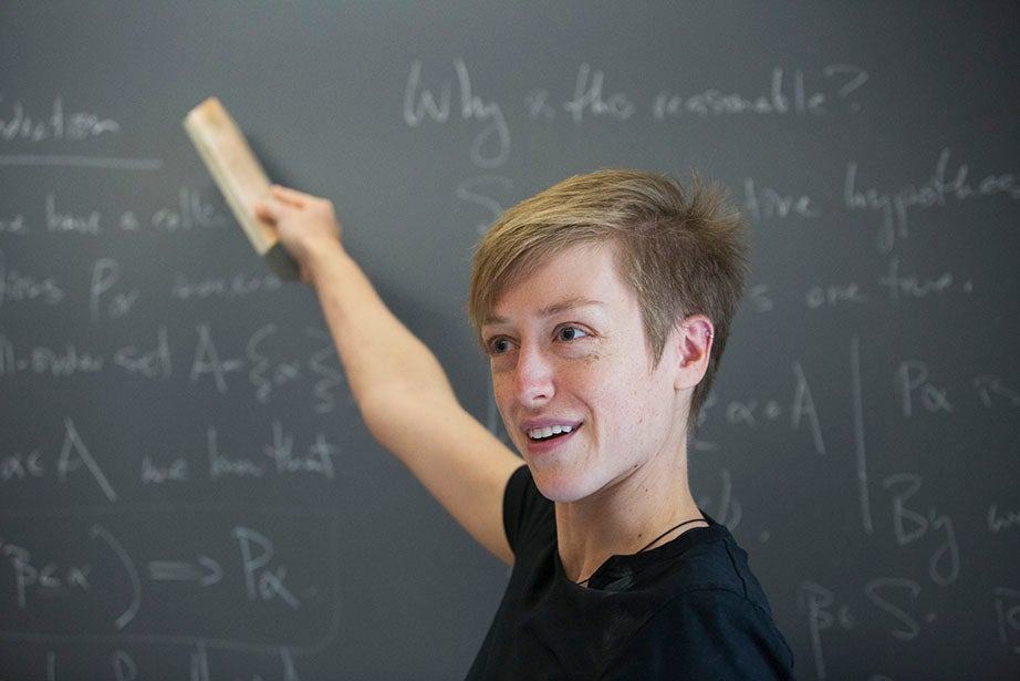 """Emily Riehl, Benjamin Peirce Fellow, gives instruction in """"Math 141: Introduction to Mathematical Logic"""" inside the Science Center. Jon Chase/Harvard Staff Photographer"""