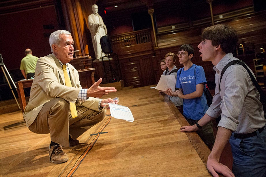 """Aron Szanto '18 (far right) talks with Thomas Kelly, Morton B. Knafel Professor of Music, as he shops """"Aesthetic and Interpretive Understanding 24: First Nights: Five Performance Premieres."""" Kris Snibbe/Harvard Staff Photographer"""