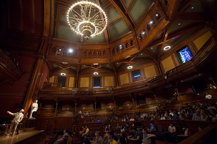 Professor Thomas Kelly lectures in Sanders Theatre. Kris Snibbe/Harvard Staff Photographer