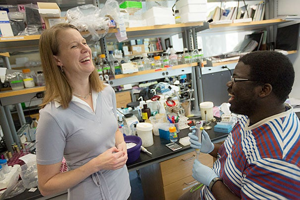 """""""As teachers, we ourselves must be perpetual students. I am continually learning from my students and exploring new ways to engage them in the material,"""" said Briana Burton, an associate professor of molecular and cellular biology, who, along with Kiran Musunuru (inset below), an assistant professor of stem cell and regenerative biology, are winners of this year's Fannie Cox Prize for Excellence in Science Teaching."""