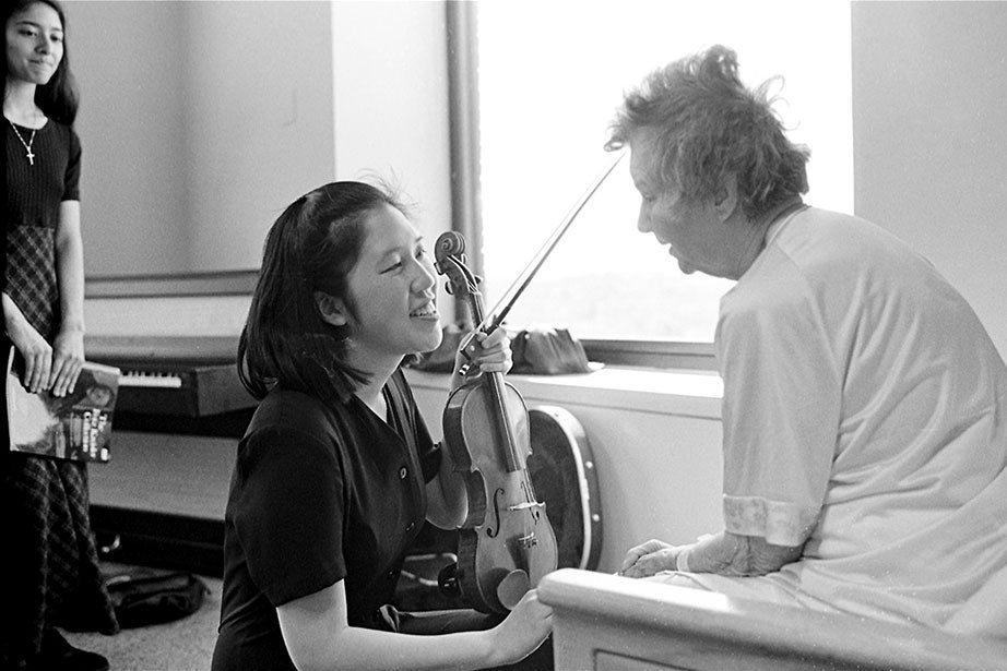 "Music across the decades. Drawing on 92 years of experience, Anna LaFosse, a patient at Beth Israel's Transitional Care Center, warmly advises student musicians Junne Kamihara '97 and Mary Farbood '97 to ""be sure to stay friends for a long time."" Kamihara founded the music-therapy program."