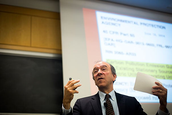 "Harvard environmental law experts Richard Lazarus (photo 1) and Jody Freeman (photo 2) joined Professor Daniel Schrag (photo 3) as  they examined the future of the nation's most sweeping climate change to date. ""It's a beautiful rule. It is incredibly creative. The question is, 'Is it legal?'"" Lazaras said during a discussion sponsored by the Harvard University Center for the Environment."