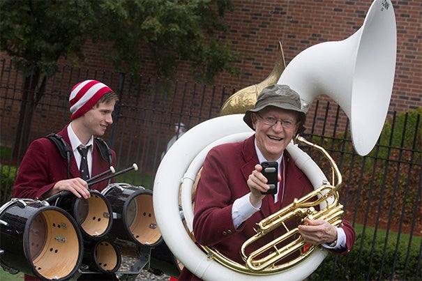 John Smith '52 (photo1) performed on his sousaphone with the Harvard Band as part of a band reunion during Community Football Day. Brian Vaughan (from left, photo 2) Tyeray Williams, Zyrck Lanier, Ray Williams, Kyle Kelley, and Edner St. Fleur enjoyed the game as Harvard beat Cornell 24-7 (photo 3).