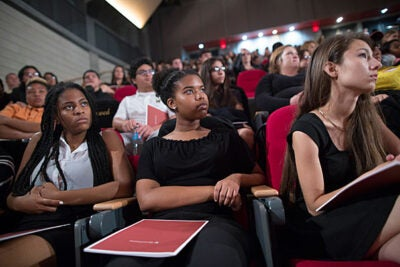 """Harvard President Drew Faust spoke at the Booker T. Washington High School for the Performing and Visual Arts. Students, including Lashaun Morgan (from left), Kennedi Mayes, and Cristina Flores listened as Faust made her """"case for college."""" Stephanie Mitchell/Harvard Staff Photographer"""