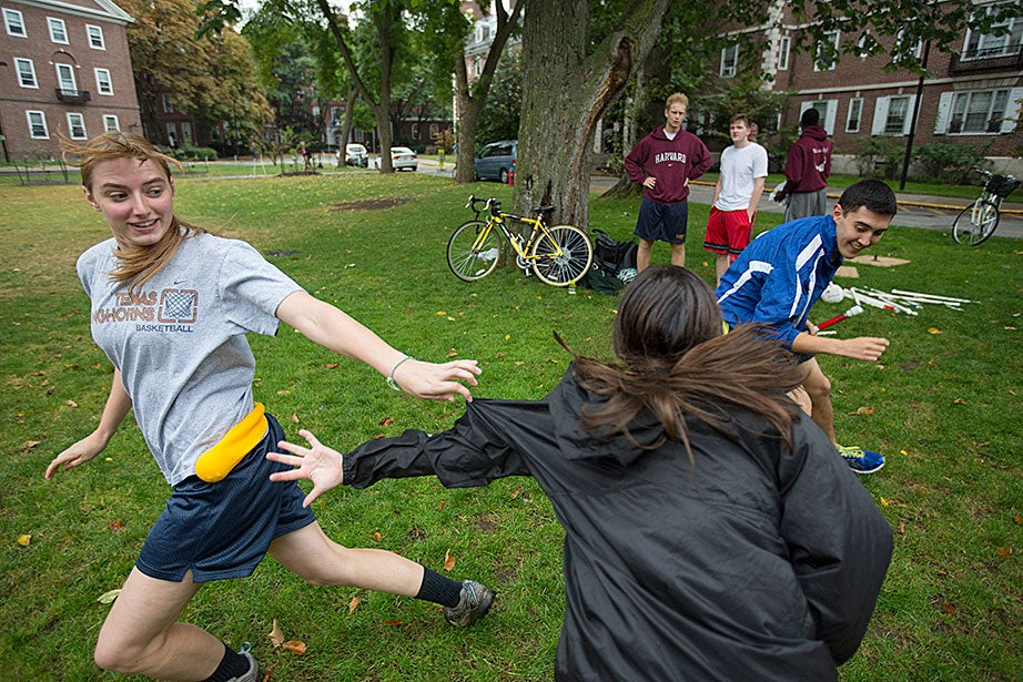 Monica Marion '17 (left) and Phillip Ramirez '18 (right) make a dash during Quidditch.
