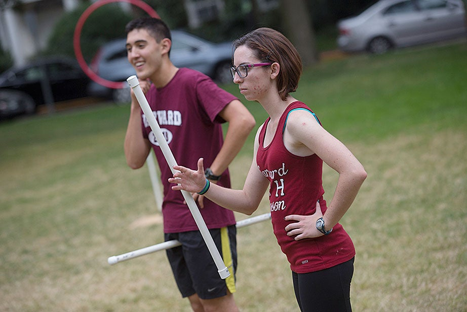 Phillip Ramirez '18 (left) and Rachel Gosselin '18 pause with their brooms.