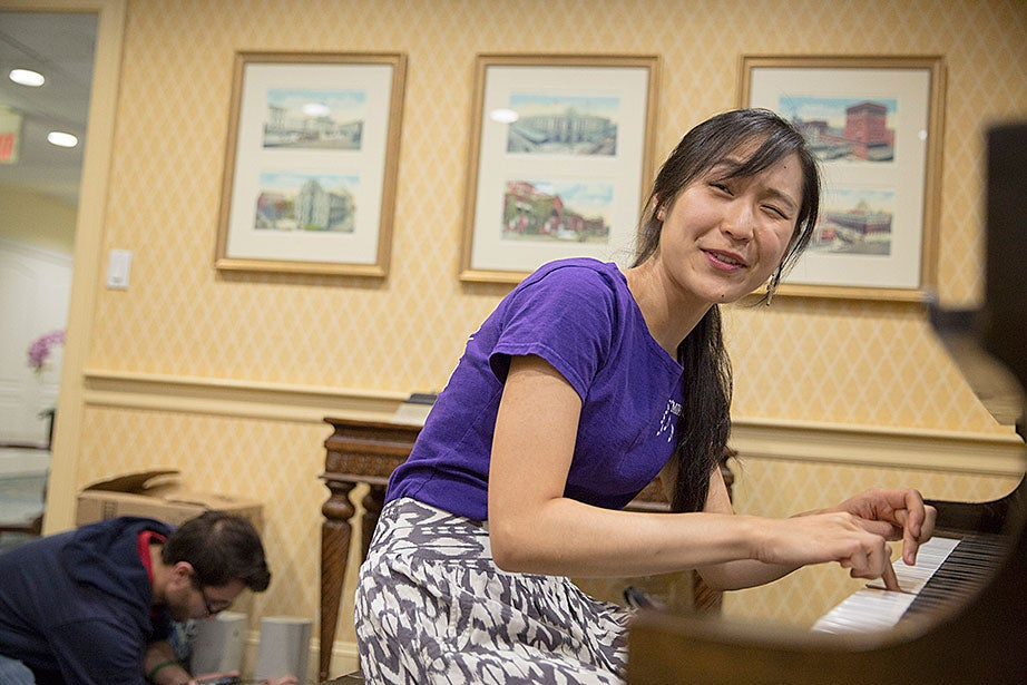 Jennifer Tu '16 tests an out-of-tune key while performing.