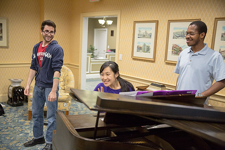 Tom Somi '14 (from left), Jennifer Tu '16, and Kevin Sikah '15 enjoy a laugh.