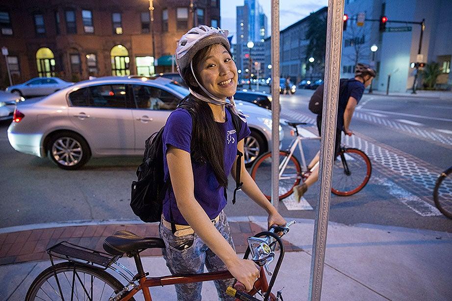 Jennifer Tu '16 rides her bike back to Harvard after the show.